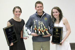 Eastern's Brittany Neeley, head coach Jeremy Dexter and Bethany Neeley hold the twins honors from the Kiwanis Club of Kokomo. (SJ Photo: William Gibson)