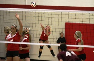 Cortney Hanson serves for the IU Kokomo Cougars in a win against Calumet College of St. Joseph. (SJ photo by William Gibson)