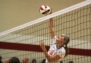 Kokomo native and Western High School graduate Shelby Spall skies for a kill against Asbury University. (SJ Photo: Douglas Hockney)