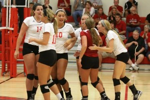 The IU Kokomo volleyball team reacts to a point scored. (Photo by William Gibson)