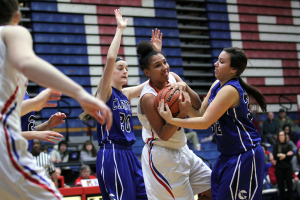 Kokomo's Allie Lowe battles for a rebound. (Photo by William Gibson)
