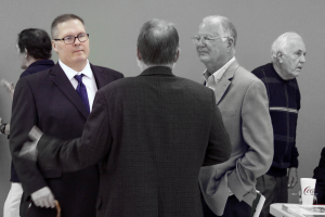 Dennis Kasey, left, talks to Rob Rube and Bob Winginer at the 2014 Howard County Sports HOF banquet.
