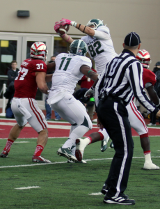 Josiah Price catches a touchdown pass against Indiana last season. (Photo by William Gibson)