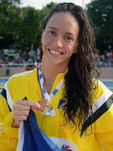 Kokomo graduate Lexi Laird shows off a gold medal from the Indian Ocean Island Games. (Photo/Patrick Joubert, Seychelles News Agency)