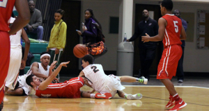 On his birthday, Ty Sparling outhustles Arsenal Tech to a loose ball in Kokomo's upset victory.
