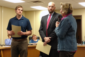 Kokomo Schools board president Crystal Sanburn presents a proclamation to Shawn Flanary as KHS AD Jason Snyder looks on. (SJ Photo: Dean Hockney)