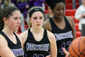 Northwestern seniors Sophia Beachy, Brianna Hahn and Beza Townsend accept the regional runners-up game ball. (SJ photo/William Gibson)
